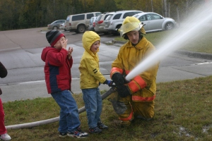 Our local volunteer firefighters visit area schools each year to talk about fire safety and to give excited kids a chance to play fireman.  The Granite Mountain Hotshots were once little boys like this. We will never forget them.