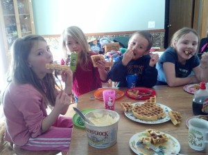 Some of the grandkids enjoying waffles on their special M&M plates.