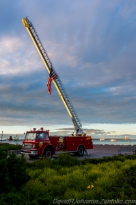 The Grand Marais Fire Department remembers 9-11 each year with a flag on its ladder truck in Harbor Park in downtown Grand Marais. The moving sight was captured by photographer David R. Johnson.